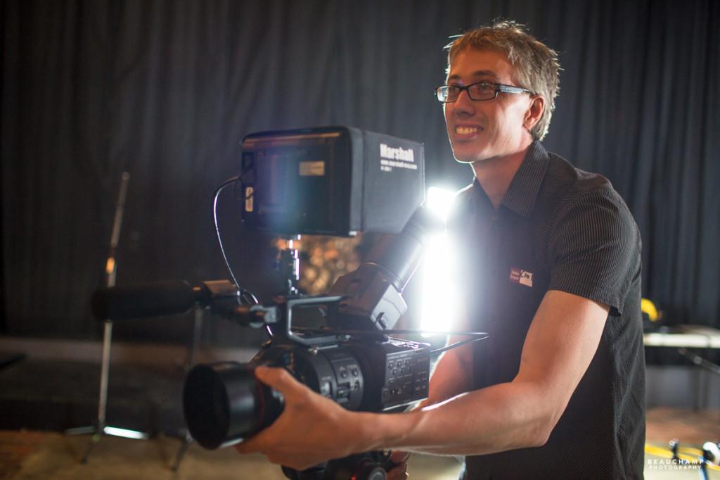 Local filmmaker Cam Belseth set up a camera demo.